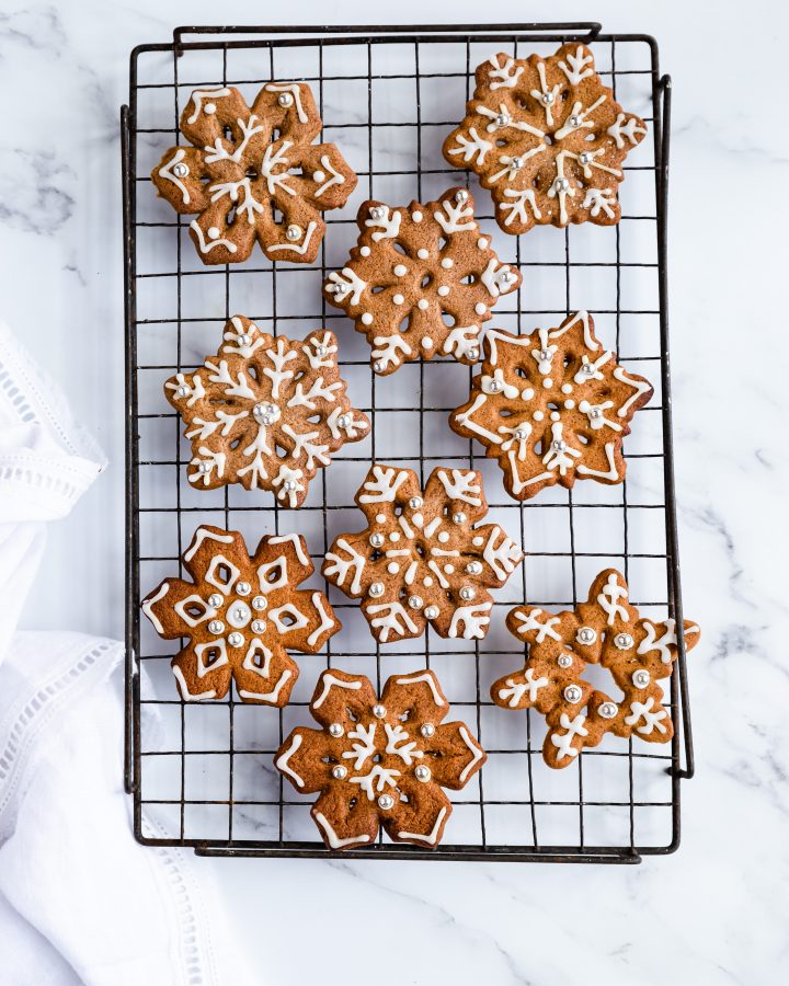 Overhead shot of gingerbread snowflakes with white icing